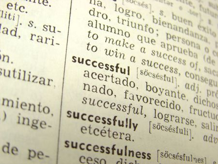 'successful' word in english-spanish dictionary - shallow depth of field Stock Photo - 3663731