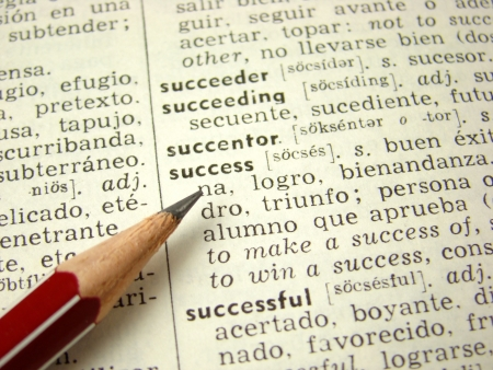 english dictionary: success word in english-spanish dictionary with pencil Stock Photo