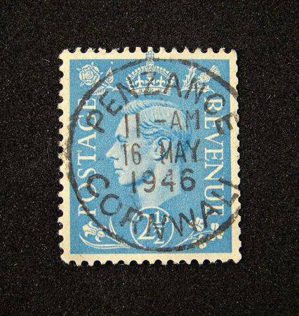 Great Britain postage stamp on black background. Stock Photo - 3736728