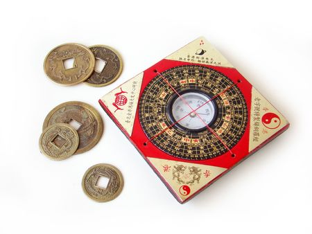 shui:   Feng shui compass (Luopan) and chinese coins on white background