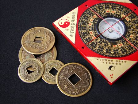 shui:   Feng shui compass (Luopan) and chinese coins on black background
