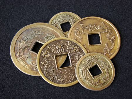 Close-up of chinese feng shui coins for good fortune and success. Stock Photo