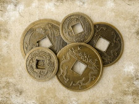 Chinese feng shui coins for good fortune and success on grunge background