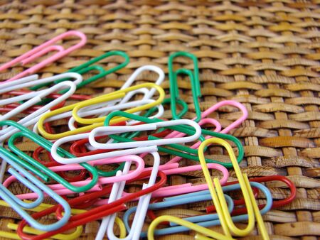 Colored paper clips on rattan background                  Stock Photo - 4374771