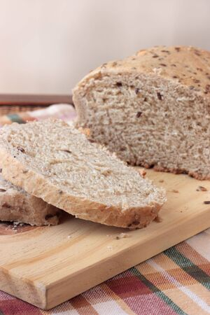 Organic wholemeal bread with seeds, sliced