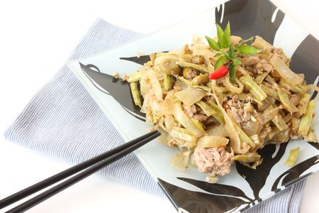 Asian style dish with vegetables and tuna fish - stir fry cooked