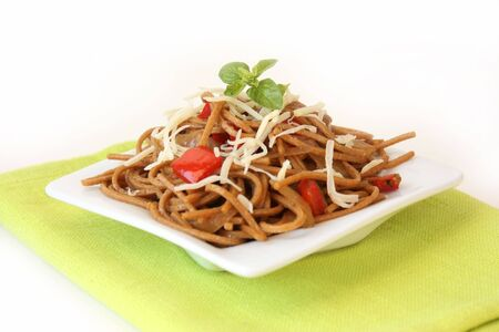 Fried noodles with vegetables and basil - isolated