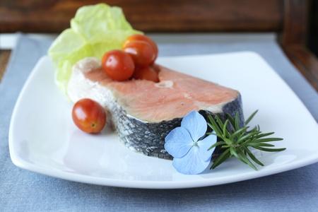 Raw salmon steak with vegetables Stock Photo