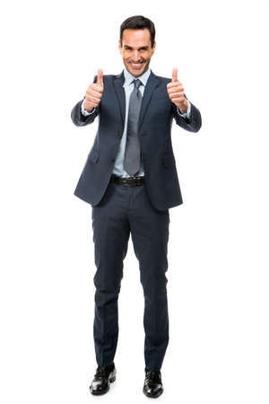 25 to 30 years old: Full length portrait of a businessman smiling and pointing finger while walking