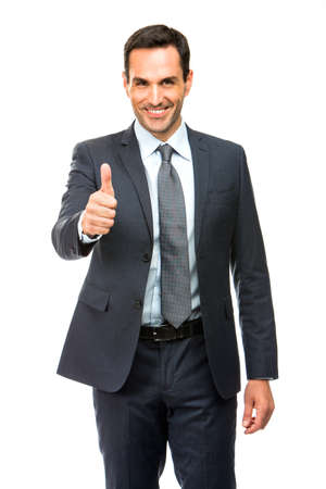 25 to 30 years old: Businessman smiling and giving ok with one hand Stock Photo