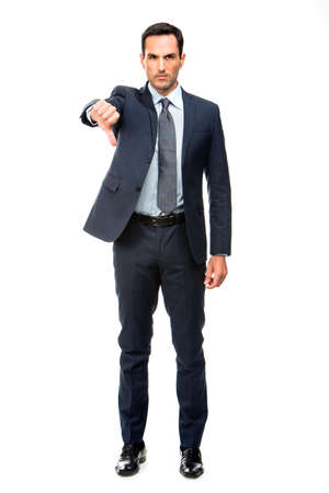 25 to 30 years old: Full length portrait of a businessman looking angry and doing ko sign with one hand Stock Photo