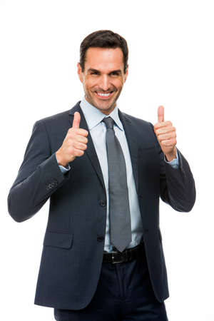 25 to 30 years old: Half length portrait of a businessman smiling and giving ok sign with both hands Stock Photo
