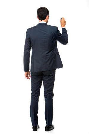 25 30 years old: Full length back view portrait of a businessman with a black marker writing on the screen Stock Photo