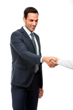 manos estrechadas: Retrato de medio cuerpo de un hombre de negocios sonriendo y estrechando la mano Foto de archivo