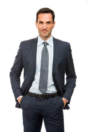 bonhomme blanc: Demi-longueur portrait d'un homme d'affaires avec les mains dans ses poches Banque d'images