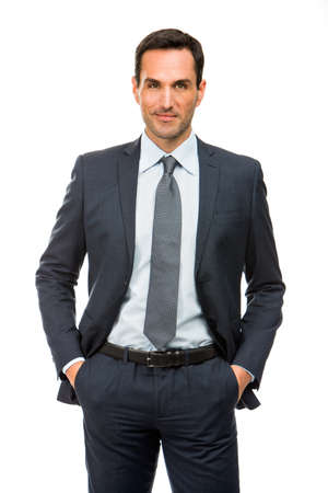 25 to 30 years old: Half length portrait of a businessman with hands in his pockets Stock Photo
