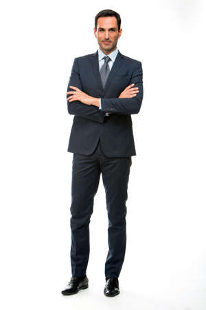 25 30 years old: Full length portrait of a businessman looking at camera with crossed arms Stock Photo