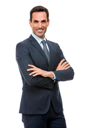 25 to 30 years old: Half length portrait of a smiling businessman looking at camera with crossed arms Stock Photo