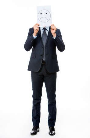 white card: Full length portraif of a businessman holding white card with emoticon on it