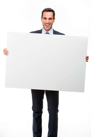 25 30 years old: Full length portrait of a smiling businessman holding a white placard Stock Photo