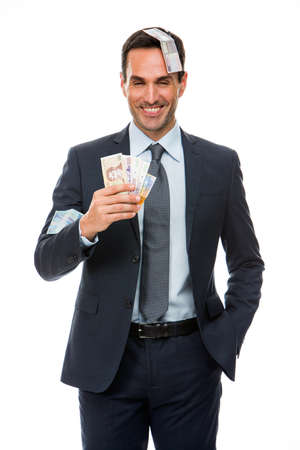 25 30 years old: Half lenth portrait of a businessman smiling in falling money Stock Photo