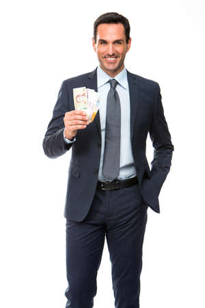 25 to 30 years old: Half lenth portrait of a businessman smiling and holding money Stock Photo