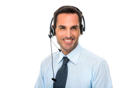 25 to 30 years old: Portrait of a smiling man with headset working as a call center operator
