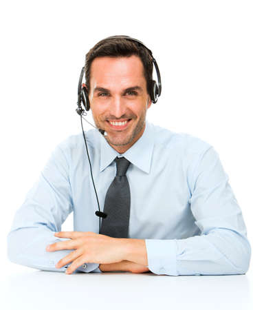 Portrait of a smiling man with headset leaning on his desk