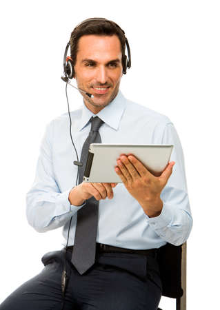sitted: Portrait of a smiling businessman with headset and dital tablet Stock Photo