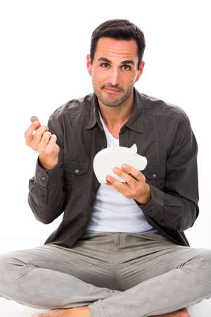 fails: Man sitted on the floor, looking at camera, putting a coin in a piggybank