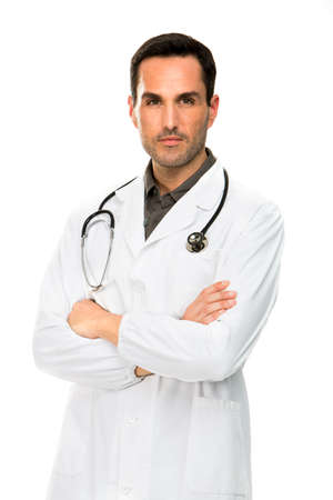 25 years old: Half length portraif of a thoughtful male doctor with crossed arms and stethoscope Stock Photo