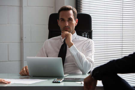 25 30 years old: Two businessmen having a meeting in the office using laptop computer and digital tablet Stock Photo