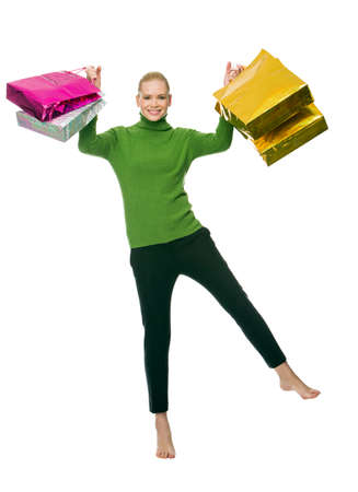 nacked: blonde smiling woman with gift bags jumping