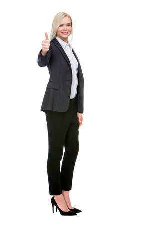 25 to 30 years old: smiling blonde businesswoman thumb up with one hand