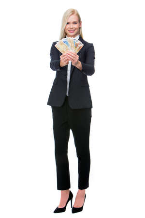 25 to 30 years old: blonde businesswoman smiling and holding money Stock Photo