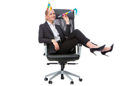 25 to 30 years old: blonde businesswoman smiling and having fun During a party in the office Stock Photo