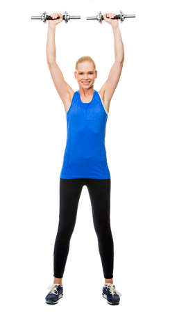 25 to 30 years old: blonde woman wearing fitness clothing exercising with weights