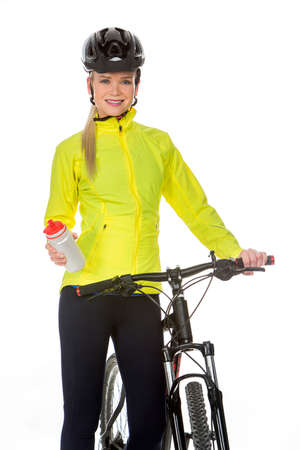 25 to 30 years old: blonde woman wearing fitness clothing and helmet while drinking next to a bike