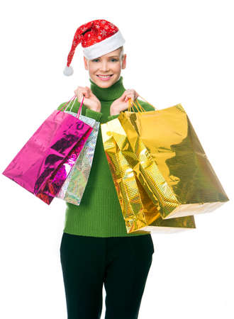 nacked: blonde smiling woman with christmas hat holding gift bags