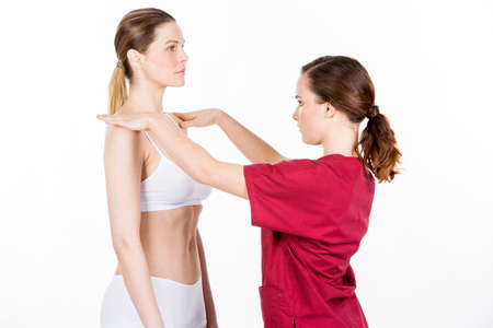 physical therapy: physiotherapist doing a physical examination of a woman