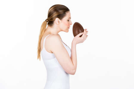 smelling: woman smelling easter egg Stock Photo