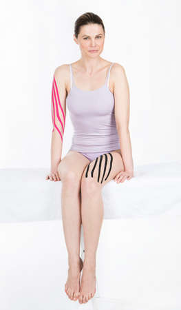 the draining: woman with draining taping on leg