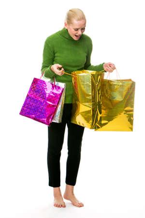 sueteres: Mujer que hace compras para la Navidad