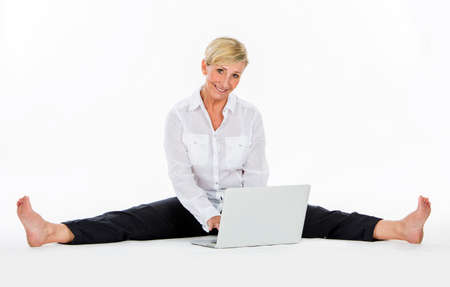 woman manager sat on the floow with laptop