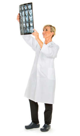 doctor woman looking at patient x-rays Banque d'images