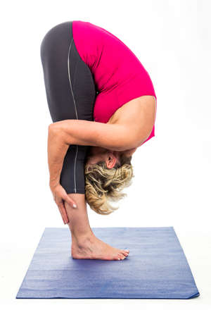 woman middle age: middle age woman doing yoga exercises