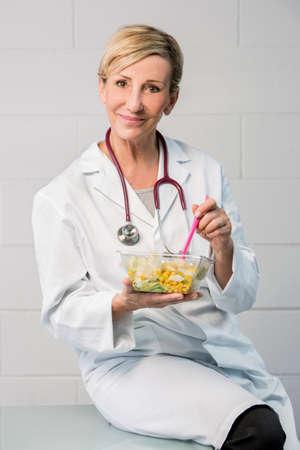 woman doctor having lunch break
