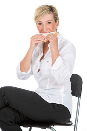 manager woman eating sandwich sat on a high chair