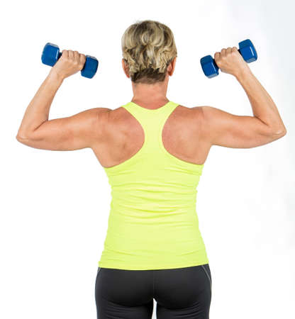 woman doing arms exercises with dumbbell Banque d'images