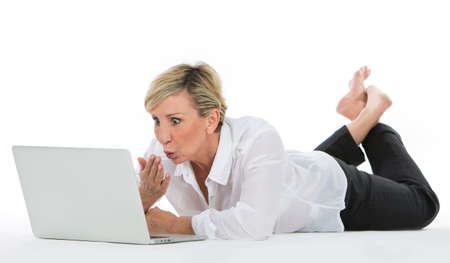 woman manager sat on the floor with laptop